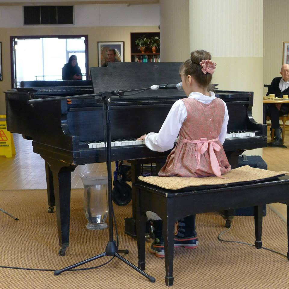 Girl Playing Piano at BWMS Recital