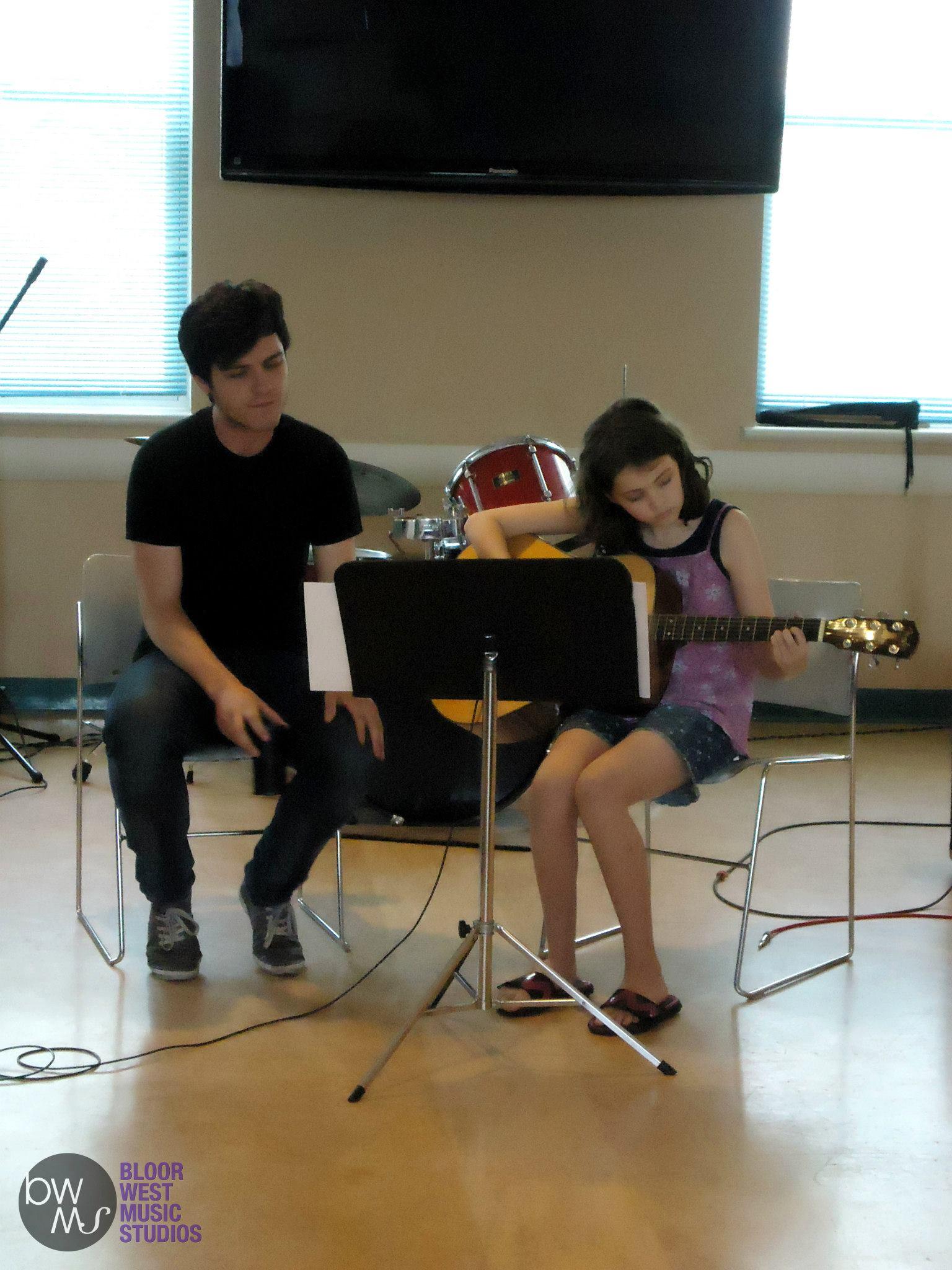 Girl Playing Guitar at Recital
